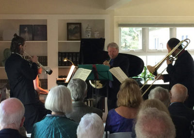 Aaron Plourde, William Purvis, and Matthew Russo perform at a benefit concert